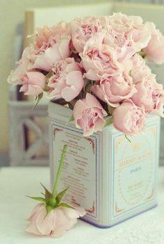 Vintage tea tin centerpiece #teapartycenterpiece #vintageteatins #bridalshowerteaparty