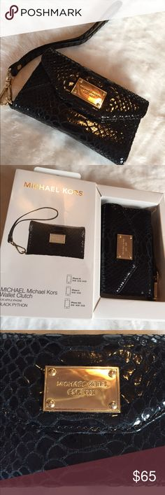 Michael Kors wallet clutch Apple iPhone 3/4 NWT Authentic MICHAEL  michael  Kors wallet clutch BNWT Apple iPhone 4, 4s, 3GS. Msrp $80. Black Python w gold interior. Super cute. Opens to hold your phone,  money, id, credit cards,  wristlet. Snaps shut. Super cute.   ****reduced 12/19.  I ship next day from east coast. :)**** MICHAEL Michael Kors Bags