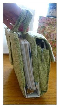 """Homeschooling little ones–the """"learning basket"""" Half sized binder cover variation. It has a large pleated pocket on the outside, to carry a bulky booklet. Fabric Crafts, Sewing Crafts, Sewing Projects, Mochila Tutorial, Roterfaden, Bible Covers, Fabric Bags, Sewing Accessories, Learn To Sew"""