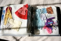 Great idea for organizing Barbie clothes.  A binder and gallon ziploc bags with holes punched in them.