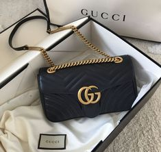 """Gucci bags now come in a number of sizes, shapes, colors, and designs. They are made and marketed throughout the world bearing the name """"Gucci"""" and a reputation for quality and design. Pink Gucci Purse, Vintage Gucci Purse, Gucci Purses, Gucci Handbags, Luxury Handbags, Purses And Handbags, Designer Handbags, Gucci Bags, Black Gucci Bag"""