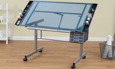 The Vision Blue Glass Craft Station features tempered safety glass, blue silver color, and the dimensions are 30″ by 41″ by 26″. #art #artist #drawing