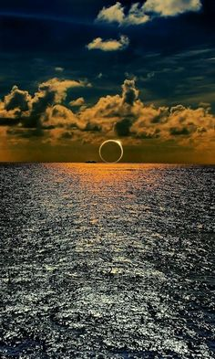 An image purportedly showing the solar eclipse over the South Pacific Ocean is a digitally-manipulated fake. The photo is actually a digital composite of an eclipse and a sunset—both of which are c… Image Nature, All Nature, Amazing Nature, Science Nature, Beautiful Moon, Beautiful World, Beautiful Images, Pretty Pictures, Cool Photos