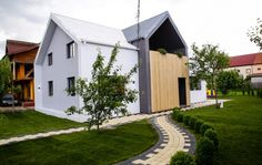 Scandinavian style architecture, house in Romania, white and black house