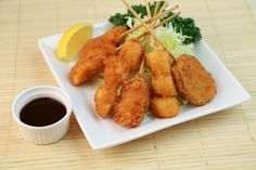 """""""Kushikatsu"""" has long been loved by the people of Osaka. It is very reasonably priced with one stick for about 100 JPY at the general restaurants. They are eaten deep-fried and smothered in sauce. It's the best match with ice-cold beer! Here are some recommended restaurants as well as important rules to remember when eating kushikatsu."""