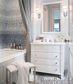 Designer Sandra Nunnerley adds tranquil glamour to a his-and-hers bathroom in New York City, where the use of mosaic tile creates two different looks — one soft, one bold. Mist mosaic tile by Studium has a watery, pearlescent glow. Vintage sconces from nicholas Antiques. Polished nickel fixtures and Easton stool by Waterworks. Towels by E. Braun & Co. See the rest of the space.