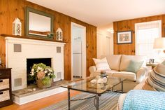 House of Turquoise: Judy Cook Interiors = (1) White windows and frames look a little odd with pine paneling. (2) Like the seating arrangement with couch and loveseat. Cozy around fireplace.