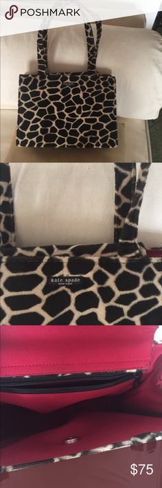 Vintage Kate Spade handbag Gorgeous giraffe print Kate spade tote from her first collection! Carried maybe once or twice it is in fantastic condition has been in a dust bag in my closet for years. The measurements are 7 inches from top to bottom 11 inches across I have no proof of authenticity but it's a gorgeous bag in excellent condition ! It is covered in a suede like animal print and looks like new! kate spade Bags Shoulder Bags