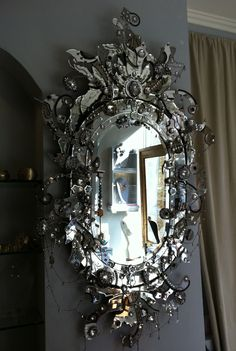 Mirror!   Erickson Beaman is a jewlery designer and is crossing over into home design. Has a gothic or steampunk feel...I think I just died!!