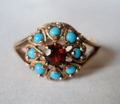 his fabulous 9k gold ring is a genuine antique from the Late-Victorian Period -- circa 1885-1910. It features garnet and turquoise in an Ottoman inspired gold setting.