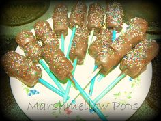 I made this Marshmellow Pops thanks to 'Taste of Home magazine-fun food & they came out yummy.My little man was eager get his hands on them that he grab a spoon from draw and scooping the chocolate off lol.  ALL YOU NEED:  *-Marshmellows  *-Chocolate  *-Sticks  *-Sprinkles