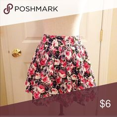 """F21 Floral Skirt Such a sweet little floral skirt. Lined to give it a little volume. Perfect condition. Size small from F21. 13"""" across at waist  16"""" long Forever 21 Skirts"""
