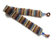 Good inspiration to use up bits of colors:  Seed Bead Bracelet, Peyote Stitch, Delica, $20.99, via Etsy.