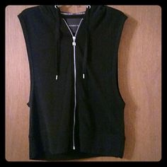 Victoria's Secret Hooded Sleeveless Sweatshirt * A black edgy and sporty sleeveless sweatshirt from Victoria's Secret!! <3 Oversized arm holes to show off a cute tanktop or bandeau bra and a comfy hood to go with! Has the VS signature wings zipper pull and drawstrings. Perfect for layering or pairing with a cute  pair of lounge pants.  *Only worn once and in great condition!*  Brand : Victoria's Secret Size: Medium Color: Black Victoria's Secret Tops Sweatshirts & Hoodies