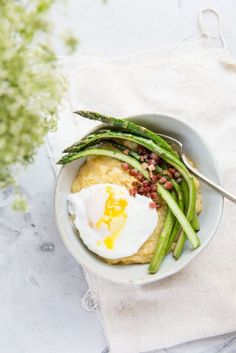This easy 20 minute recipe is great for dinner or breakfast - Polenta with Asparagus, Pancetta and Poached Eggs.