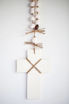 Price: Starting at $60.00 Clay cross handmade in Australia. White earthenware clay glazed with a beautiful gloss glaze. Natural twine with clay pebble beads make this a beautiful wall hanging. You can personalise this gift by handwriting a message on the back (unglazed side) with a felt pen. Available in small, medium and large. Small: 120mm h x 96mm w, overall drop length 300mm Medium: 175mm h x 130mm w, overall drop length 400mm Large: 250mm h x 170mm w, overall drop ...