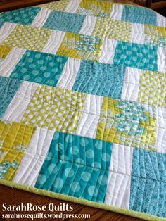 Modern Squares Quilt with herringbone quilting design.