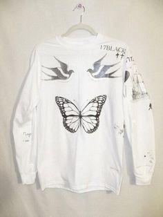 a hoodie with Harry' s tattoos. I WANT ONE SO BADLY