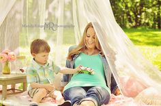 Styled mommy and me mini sessions with a hoop canopy hanging from a tree over layered blankets and pillows.