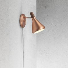 Our Float family of lights are an elegant and contemporary solution to your interior lighting demands. A much requested addition to our ever popular ceiling lights, the stunning wall lights are available in either a warm copper or smart brushed steel, both accented with beautiful oiled walnut. Featuring a switch on the wall plate and adjustable shade for complete light direction control. Cable length 180cm. Requires a max 8w LED GU10 bulb (not supplied).