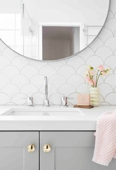 Grey and white bathroom with round mirror, grey cabinetry and fish scale tiles. Fish Scale Tile, Gray And White Bathroom, Australian Homes, Interior Stylist, Round Mirrors, Beautiful Bathrooms, Colour Schemes, Christmas Home, Tiles