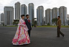 A North Korean couple pose for a wedding picture near the newly constructed development project area on Mansu Hill in Pyongyang, North Korea Wednesday, September 19, 2012. (Photo by Vincent Yu/AP Photo) http://avaxnews.net/educative/A_Look_Inside_North_Korea.html