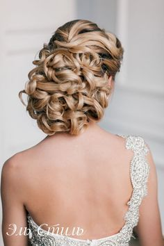 curly updo hairstyle for wedding and one shoulder wedding dress