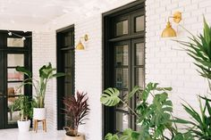 Elsie's Sunroom Tour (Before + After) - A Beautiful Mess - Cassidy Bernstein - Elsie's Sunroom Tour (Before + After) - A Beautiful Mess Elsie's Sunroom Tour - love the white and black with gold accents - White Wash Brick, White Brick Walls, White Brick Houses, White Bricks, Decorative Water Fountain, Sunroom Decorating, Decorating Tips, Interior Decorating, Sunroom Office