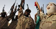 """ISIS FIGHTERS YELLING """"ALLAHU AKBAR"""" PARADE SEVERED HEADS IN LIBYA"""