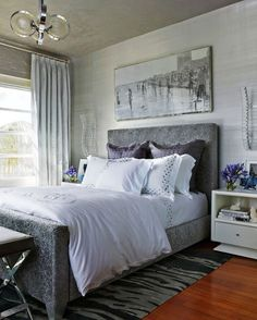 A white, silver, and purple palette make the master bedroom a serene retreat. www.traditionalhome.com