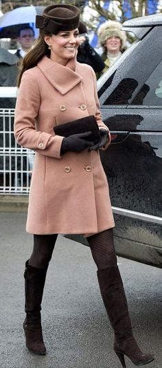 "Duchess of Cambridge @ 4 and half months..  pink coat by Joseph Fashion, accessorized with brown felt James Lock & Co. Ltd. ""Betty Boop"" hat, ""Natasha"" clutch by Emmy Shoes, ""Zipkin"" knee-high boots by Stuart Weitzman, and a pair Cornelia James Side Bow Wool Gloves'""."