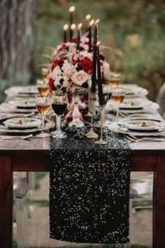 You can still have elegance with a rustic feel. The black sequin runner and black taper candles on gold holders really add that glamorous look to this country theme.