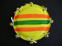 Homemade Tamborine Here's what you'll need... • 2 Paper plates • Glue • Bells • Yarn or ribbon • Paint and Brush Here's how you make it... 1. Paint your paper plates - eating side down. Once they're dry glue your plates together. After they are securly in place punch holes around your paper plate. With yarn or ribbon, tie on your bells. Now you're ready to make some music!