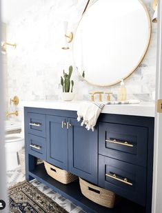 gold Bathroom Decor Modern bathroom design featuring a blue vanity and gold accents. This combination of bathroom hardware pops against the blue vanity to brighten up a bathroom. Photo via leftandlevel Beautiful Bathroom Decor, Blue Vanity, Bathroom Interior Design, Bathroom Wallpaper, Modern Bathroom Design, Bathroom Makeover, Bathroom Mirror, Gold Bathroom, Bathroom Renovations