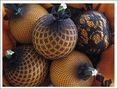 Pumpkins placed inside nylon stockings take on a whole new look!
