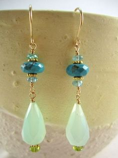 The blues and greens of these jade and turquoise earrings will make you dream of the Caribbean. Golld filled ear wires. 1 3/4 inches long