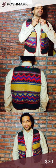 Native American influence vest. Bright and colorful wool-blend vest. Features vintage wooden toggle detail. Two small pockets on the front. Vintage Suits & Blazers Vests