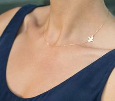 A Beautiful, Simple Bird Silhouette is suspended in thin gold chain. A Delicate Gold Necklace with an elegant, graceful style.  Necklace: SOAR -