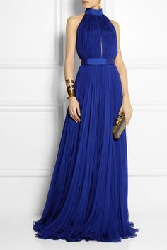 ALEXANDER MCQUEEN Plissé silk-chiffon gown $7,460 Alexander McQueen's dramatic royal-blue gown is crafted from swathes of feather-light plissé silk-chiffon. This stunning design features an alluring cutout back, a snap-fastening belt to accentuate your waist and a billowing floor-sweeping skirt. Wear it to your next special event with gold jewelry and heels. Shown here with: IAM by Ileana Makri earrings, Hervé Van der Straeten cuff and cuff, Giuseppe Zanotti shoes, Alexander McQueen clutch.