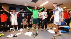 Benedikt Hoewedes of Germany, Manuel Neuer of Germany and Thomas Mueller of Germany celebrate in the Germany dressing room