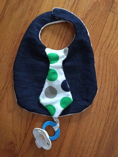 Baby shirt tie drool bib with binky pacifier holder, denim blue with absorbent white terry cloth backing