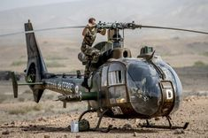 Trainee mechanic of French Armée de Terre ALAT (Army Light Aviation) works on a Gazelle reconnaissance and support helicopter.