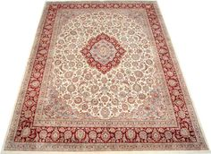 Kashan rugs are most famous of Persian carpet design for their expansive floral patterns and all-over Shah Abbas field.  http://www.alrug.com/5228