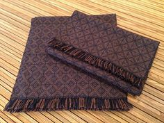 I could see doing this in black/silver/red... Ravelry: shelbyart's Men's Shadow Weave Scarves