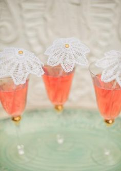 Drinks with lace parasol stirrers, so cute!
