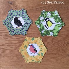 Garden bird hexies - A starling with wild pansy, great tit with wood anemone and chaffinch with daffodil fabrics. All fabrics designed by Sea Parrot. Pansies, Daffodils, Wood Anemone, Chaffinch, Great Tit, Patchwork Fabric, English Paper Piecing, Starling, Bird Art