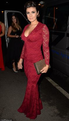 Red hot! Kym Marsh, 40, turned heads of everyone in a form-fitting crimson gown as she headed in for a fun-filled night with her family at the GEM Appeal Winter Ball on Saturday