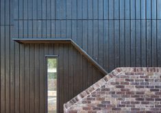 Russwood's Charred Larch Cladding uses European Larch timber produced in a controlled factory environment to create a uniquely textured black finish. Wood Cladding Exterior, Larch Cladding, House Cladding, Brick Facade, Timber Stair, External Cladding, Phoenix Homes, Painted Stairs, Garden Studio