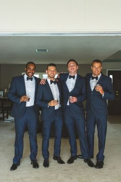 Navy suits with black bow ties