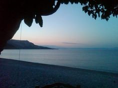 Evening view of Poulithra Bay from another restaurant taken while I was on my cell phone.